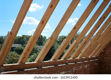 Roof trusses not covered with ceramic tile on a detached house under construction, visible roof elements, battens, counter battens, rafters. Industrial roof system with wooden
