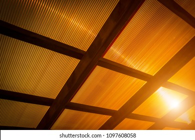 The roof of the veranda is made of orange polycarbonate.