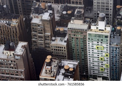 roof and water towers on top of new york manhattan skyscrapers building