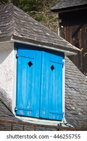 roof window with blue wooden shutter of a mountain hut, pyrenees, south france