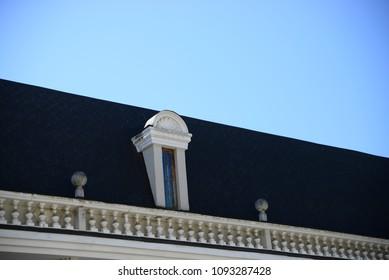 roof with window on blu sky