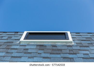 Roof window ,Sun clear glass windows at the roof of house for sun light pass heater in home.