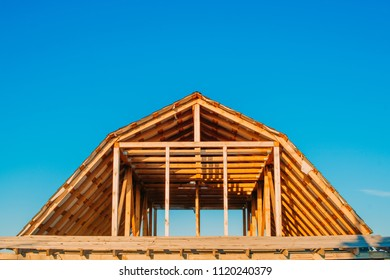 roof of a wooden house under construction with rafters