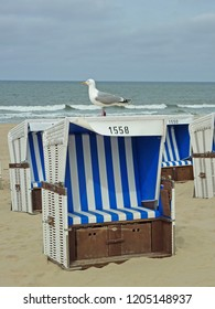 Roofed wicker beach chair at the coastline of Westerland/Sylt infront of the ocean