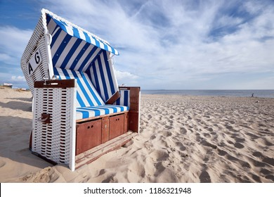 roofed wicker beach chair on baltic sea beach
