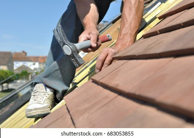 roofer nailing slats on a roof for renovation