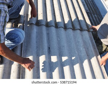 Roofer Repair and Replace Dangerous Asbestos Old Roof Tiles.
