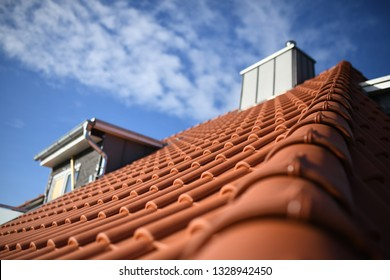 roofer shows red clay material tiles on residential building, roofers work by craftspeople with roof texture and zinc cladding