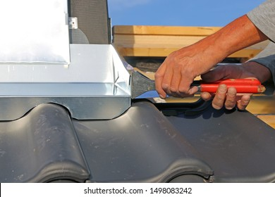 Roofer working on exterior chimney cladding