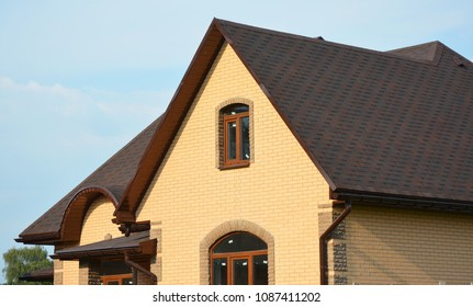 Roofing construction house building with asphalt shingles, rain gutter and roof ventilation. Close up on asphalt roofing shingles.