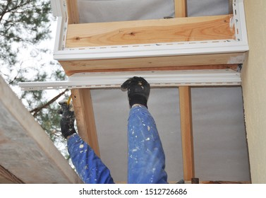 Roofing Construction. Roofer contractor installing and repair on house roof soffit and fascia.