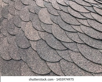 Roofing, made of shingles. Texture of shingles. Diagonal photo of soft Shingles tiles. Texture of the soft roof. Roofing construction materials.