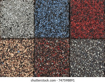 Roofing material asphalt shingles samples of various colors, closeup