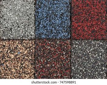 Dachmaterial aus Asphalt Gürtelrose Muster verschiedener Farben, Nahaufnahme