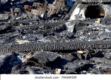 Roofing materials burned and fallen to the ground amongst the debri from napa valley wildfire. Structure burned in Santa Rosa California
