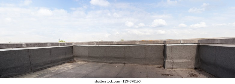 roofing on a flat roof of a building in the city