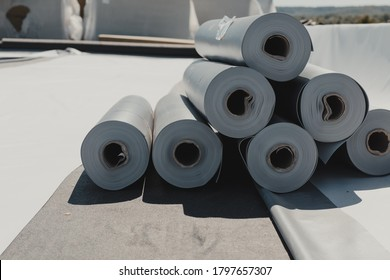 Roofing PVC membrane in rolls placed on the roof of a hall.Rubber membrane ready to be mounted.