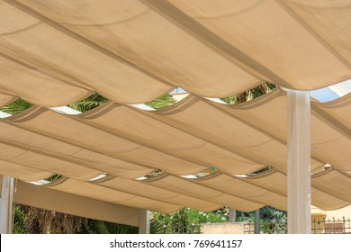 Roofing of a terrace with rope tensioning awnings