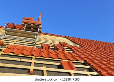 Roofing work, new covering of a tiled roof - Shutterstock ID 1823847185