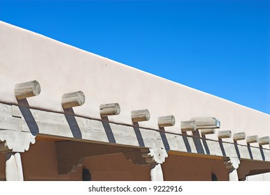 Roofline of Adobe /  Stucco Structure with Sunny Sky and Pole Shadows