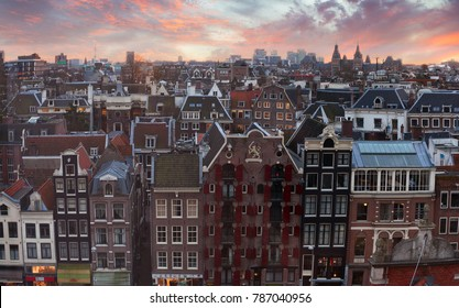 Roofs of Amsterdam at sunset,  Netherlands. Top view of old-time houses.