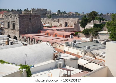 The roofs of buildings in Corfu Greece, summer, afternoon sun, blue sky, urban architecture.