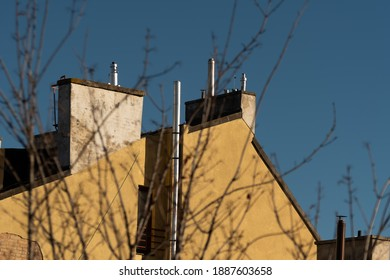 Roofs and chimneas of old and high quality buildings in the district of Prague 6, close to the historical district of Prague