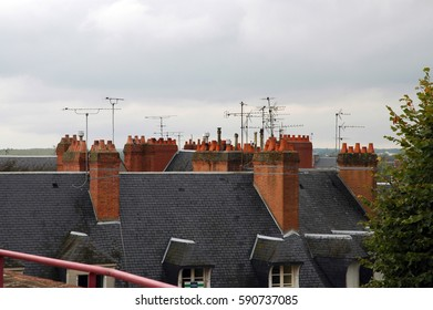 roofs with chimneys and antenna systems/roofs of a french town/view over roofs