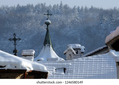 Roofs covered with snow and parts of the church in the town of Veliko Tarnovo in Bulgaria