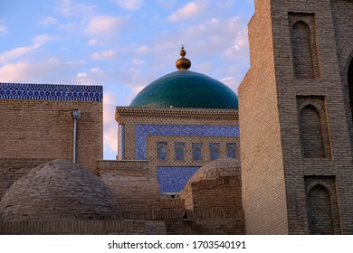 Roofs and cupolas of old town in sunset light, in Khiva, Uzbekistan. Central Asia travel view