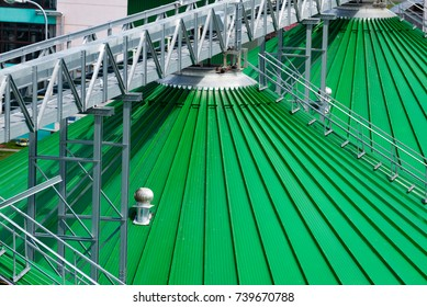 Roofs of grain silos with scraper conveyors attached to them. A modern warehouse of wheat and other cereals. View from above.