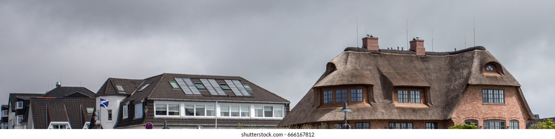 Roofs of houses with beautiful windows