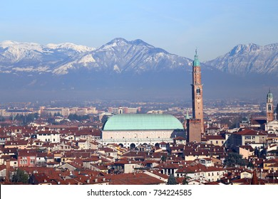 roofs of the houses and the historic monument called BASILICA PALLADIANA in Vicenza City in Italy venue of the exhibition of Van Gogh paintings