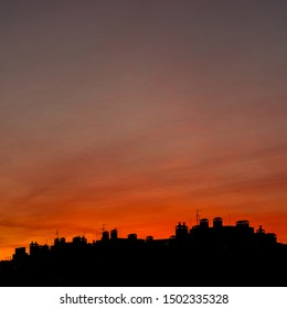 Roofs of houses on a background of a beautiful sunset