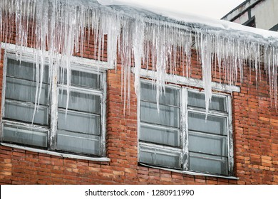 roofs of houses and windows in huge hanging icicles. Winter is harsh in the city