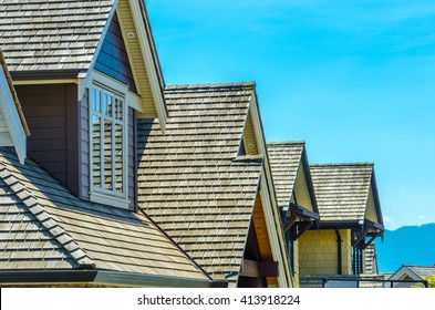 Roofs of a modern houses in great neighborhood, in suburbs of Vancouver, Canada.