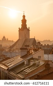 Roofs of old houses and Latin Cathedral at sunset, downtown Lviv, Ukraine