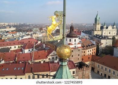 Roofs of old town and goat on the steeple of the city hall in Lublin, Poland, quad copter view.