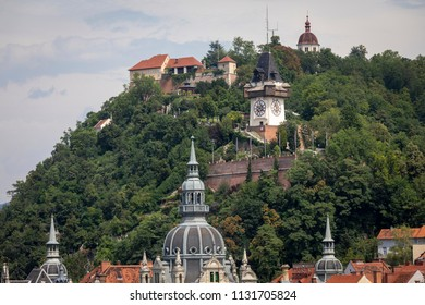 roofscape city of graz with schlossberg hill and clocktower, austria