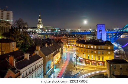 Rooftop Aerial View of British Cityscape at Night with Full Moon, Newcastle, UK