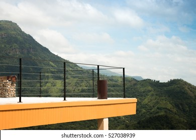 Rooftop balcony with beautiful nature mountain and blue sky background.