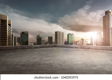Rooftop balcony with cityscape at sunset