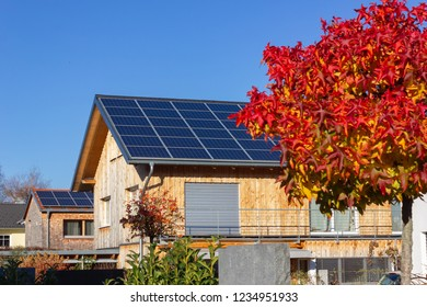 rooftop of buildings with solar panels in germany bavaria colorful autumn sunhine afternoon