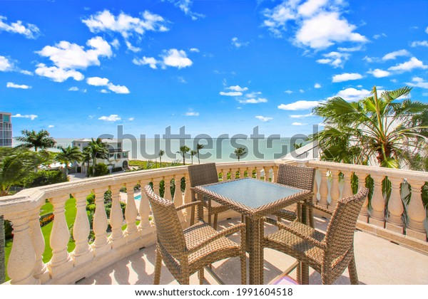 Rooftop deck at a home in Florida with furniture and a view of the beach