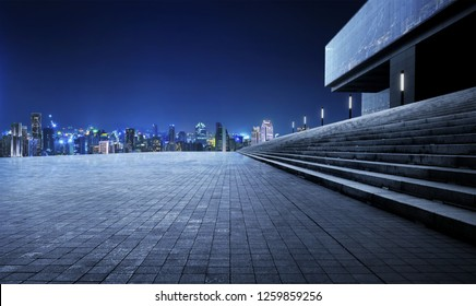 Rooftop empty brick floor and night city skyline