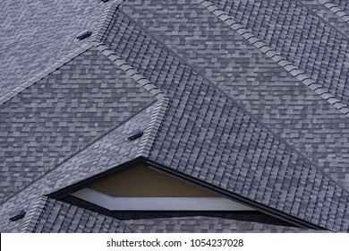 Rooftop in a newly constructed subdivision in Kelowna British Columbia Canada showing asphalt shingles and multiple roof lines