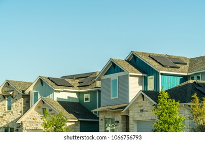 Rooftop Solar Panels on green renewable energy homes in Urban modern houses and homes in modern suburb the best place to live in Austin Texas a modern suburbia neighborhood sustainable future