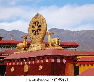 The rooftop statues of two golden deer flanking a Dharma wheel in Jokhang temple, Tibet