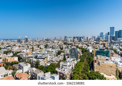 Rooftop view of boulevard Rothschild in  Tel Aviv. Old houses and modern skyscrapers.