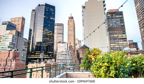 Rooftop view of Manhattan buildings at sunset, New York, USA.